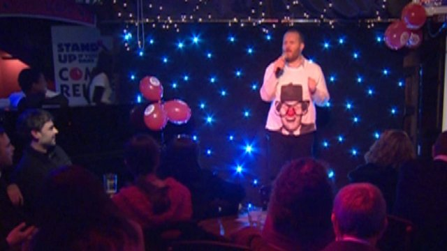Man on stage for Comic Relief