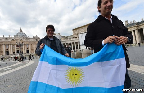 Two men brandish the Argentine flag on St Peter's Square, Rome, 15 March