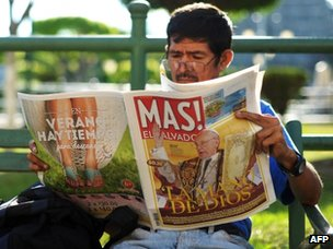 A man in El Salvador reads a newspaper announcing the election of Jorge Bergoglio as Pope (14 March 2013)
