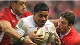 Wales' Toby Faletau (left) and Alex Cuthbert (right) tackle England's Manu Tuilagi in last year's Six Nations clash