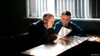 Liam Cosgrave sits in the classroom of his father's old school in Dublin with current pupil Morgan Campbell