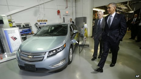President Barack Obama and Joint Center for Energy Storage Research Director Dr George Crabtree walk past a hybrid Chevy Volt vehicle used for testing during the president's tour of the Argonne National Laboratory in Argonne, Illinois 15 March 2013