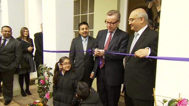 Michael Gove cuts the ribbon