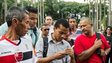 Brazilian men in San Paulo read news on a mobile phone about the election of the new Pope 