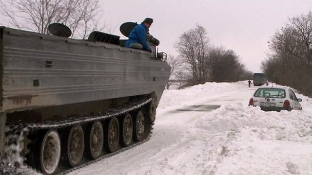 Tank and car trapped in snow