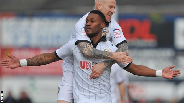 Jennison Myrie-Williams celebrates the first Vale goal with fellow scorer Lee Hughes