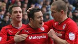 Don Cowie (centre) celebrates his opening goal for Cardiff City