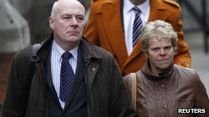 Bob and Sally (R) Dowler, the parents of murdered British schoolgirl Milly Dowler, arrive at the Leveson Inquiry at the High Court in November