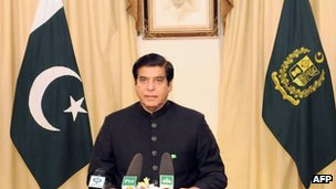 """handout photograph released by Pakistan""""s Press Information Department (PID) on March 16, 2013 shows Pakistan""""s Prime Minister Raja Pervez Ashraf addressing the nation in Islamabad on March 16, 2013."""