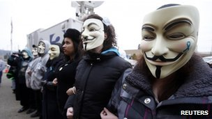 Protesters in masks outside the court