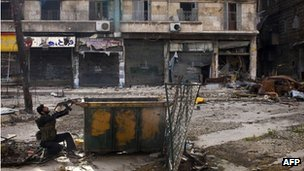 A Syrian rebel aims his weapon during clashes in Aleppo. Photo: March 2013