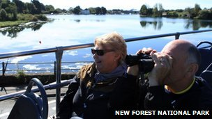 Passengers on a New Forest National Park tour bus in Lymington
