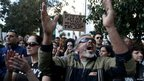 Protesters shout slogans during an anti-bailout rally outside the parliament in Nicosia on Monday
