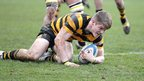 RBAI flanker Joshua Atkinson goes over to score the opening try against Methosdist College at Ravenhill
