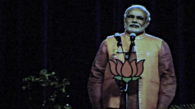 Gujarat's Chief Minister Narendra Modi broadcasts to supporters using 3D holographic technology