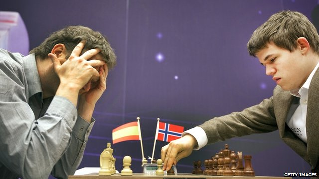 Magnus Carlsen (right) playing chess