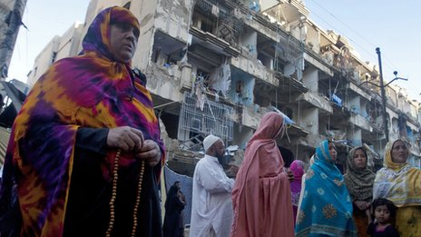 Mourners after a bomb blast  - Karachi