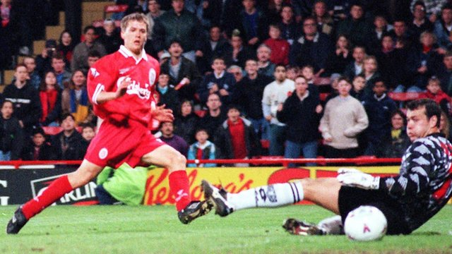 Michael Owen scores against Wimbledon