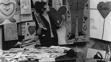 An assistant sifts through the Beatles' fan mail in 1964