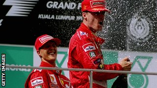 Michael Schumacher (left) celebrates with Eddie Irvine in Malaysia, 1999