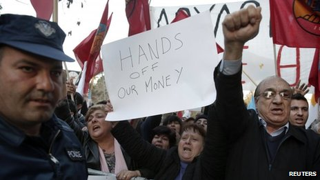 Protesters shout slogans during an anti-bailout rally outside the parliament in Nicosia
