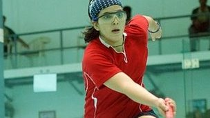 Maria playing squash