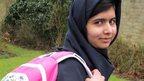 Malala with her schoolbag