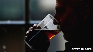 Close up of man drinking pint of beer