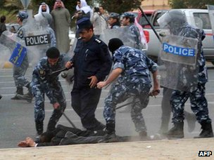 Kuwaiti riot police break up a Bidun protest in Jahra, north-west of Kuwait City, on 6 January 2012