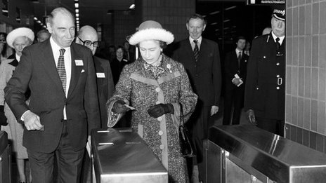 The Queen passing through a ticket barrier in 1977