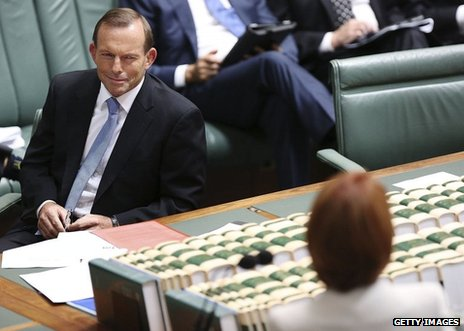 Oppostion leader Tony Abbott looks at Prime Minister Julia Gillard during House of Representatives question time
