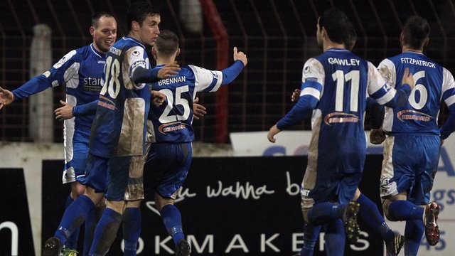 Dungannon Swifts players celebrate victory over Glentoran at The Oval