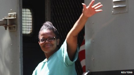 Lawyer Beatrice Mtetwa waves as she arrives at Harare Magistrates Court in Zimbabwe  on 20 March 2013
