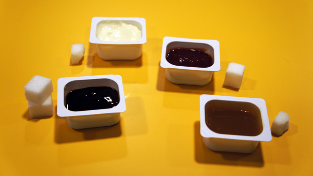Popular sauces displayed with the amount of sugar they contain in sugar cubes