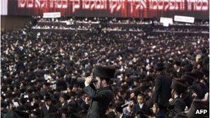 Satmar ultra-Orthodox Jewish men congregate in Brooklyn in 2011