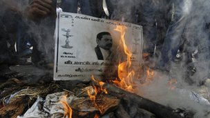College students burn a poster of Sri Lanka&quot;s President Mahinda Rajapaksa during a protest in the southern Indian city of Chennai March 21, 2013