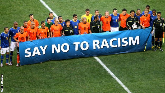 Footballers hold a 'Say No to Racism' banner
