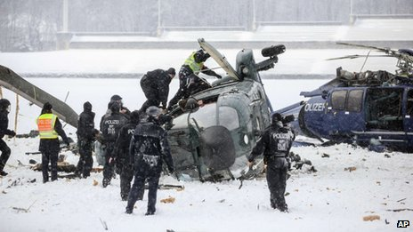 Two helicopters after a crash in Berlin