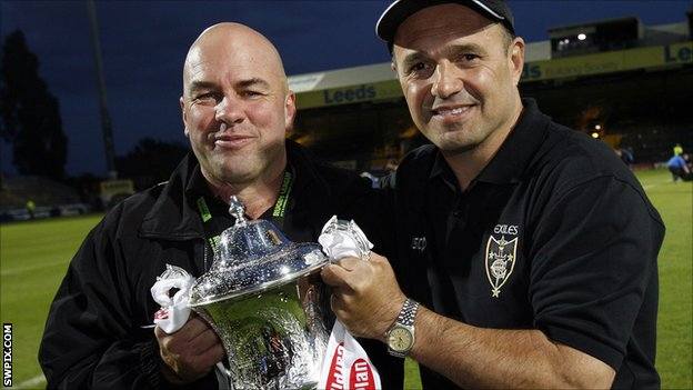 Brian McClennan and Terry Matterson celebrate the 2011 Exiles victory.