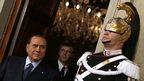 Former Italian Prime Minister Silvio Berlusconi leaves the Quirinale palace in Rome after meeting President Giorgio Napolitano