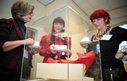 World at your Feet delegates admire a red pair of shoes designed by Vivienne Westwood