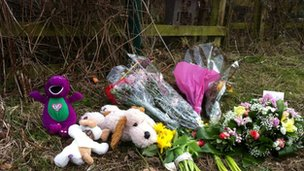 Flowers laid at the scene of where the baby was found