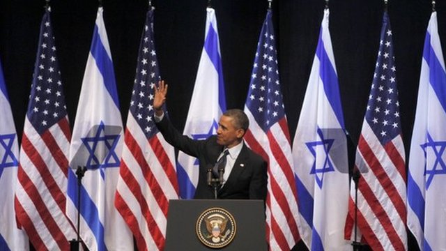 President Barack Obama waves before addressing Israeli students at the International Convention Centre in Jerusalem