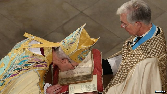 Archbishop kisses bible