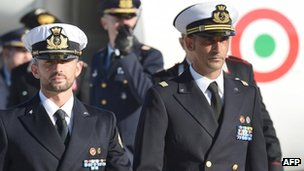 File pic of Italian marines Massimiliano Latorre (R) and Salvatore Girone (L) arriving in Italy on 22 Dec 2012
