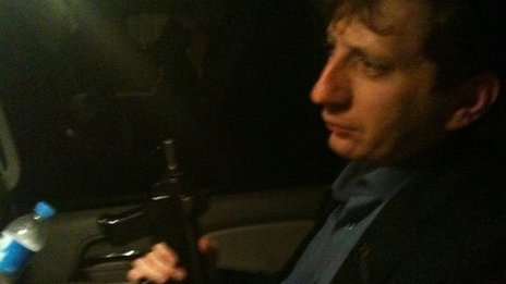 Pictures appeared in the web showing Babak Zanjani carrying weapons