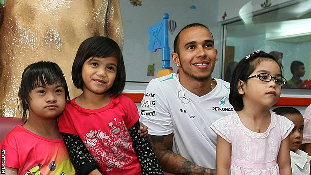 Lewis Hamilton visits a children's hospital