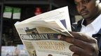 A man in Kenya reading a newspaper
