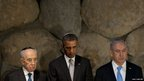 Israeli President Shimon Peres (left) stands next to US President Barack Obama and Israeli Prime Minister Benjamin Netanyahu during a moment of silence in the Hall of Remembrance at the Yad Vashem Holocaust Museum in Jerusalem