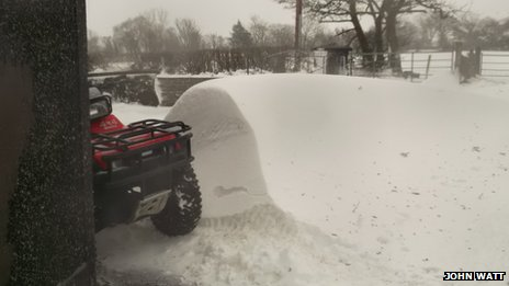 Snow drift beside quad bike